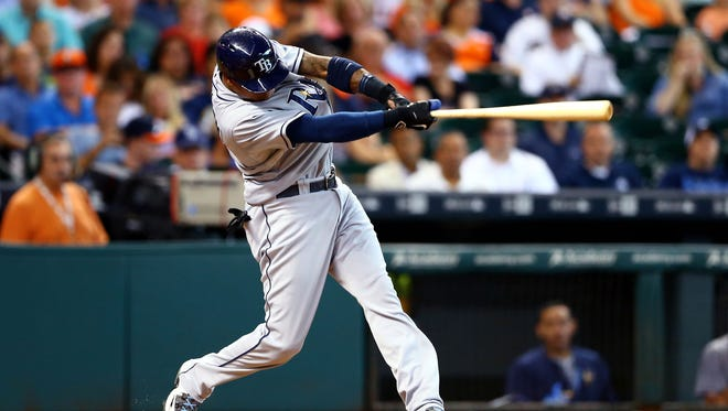 Tampa Bay Rays second baseman Tim Beckham hits a three run home run in the first inning against the Houston Astros