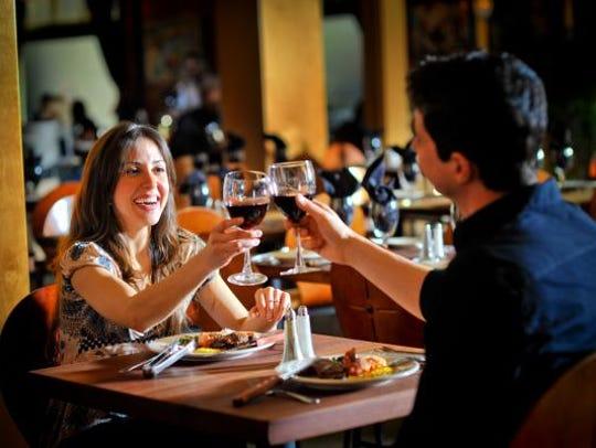 Customers dine at a Rodizio Grill.