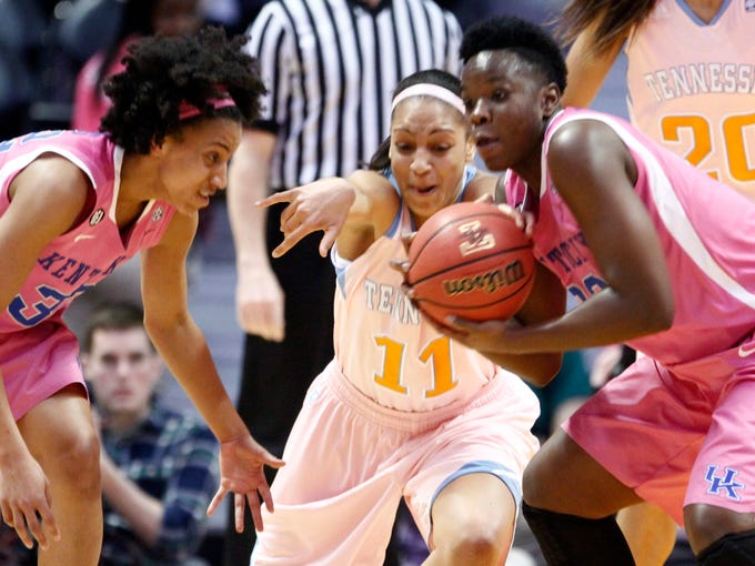 Tennessee forward Cierra Burdick (11) battles for the ball with Kentucky's Samarie Walker, right, and guard Kastine Evans (32) in the first half of an NCAA college basketball game on Sunday, Feb. 16, 2014, in Knoxville, Tenn. (AP Photo/Wade Payne)