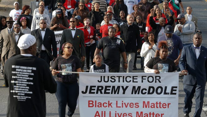 """A protest of the fatal shooting by police of Jeremy """"Bam"""" McDole is held in Wilmington on Dec. 12. The family of McDole is suing the Wilmington Police Department and the city."""