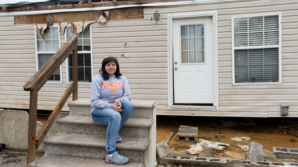 Virginia Ming with what remains of her home in McMinn
