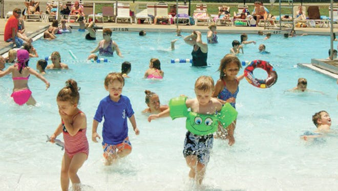 All ages enjoy a day at the Fairview Recreation Complex swimming pool.