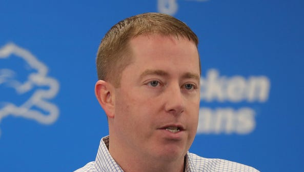Lions general manager Bob Quinn speaks to reporters
