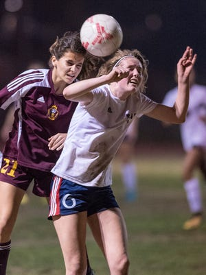 Tulare Union's Kaitlin Limas, left, and Tulare Western Sierra Levy go up for a kicked ball in an East Yosemite League high school girls soccer game on Wednesday, February 7, 2018.