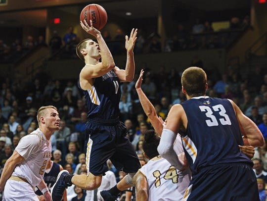 Augustana's Adam Beyer (11) goes up for a shot during