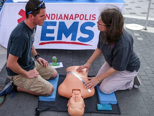 From left, Aaron McConnell learns how to give CPR from