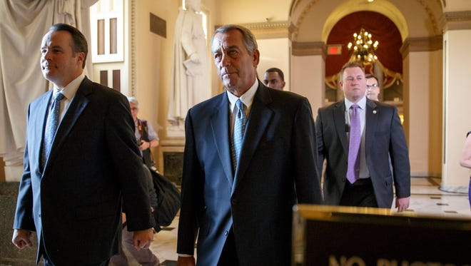 Speaker of the House John Boehner, R-Ohio, walks to the chamber as the House failed to advance a short-term funding measure to keep the Department of Homeland Security funded past a midnight deadline on Feb. 27, 2015.  The House later passed a seven-day funding extension.