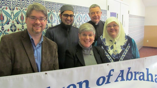 Children of Abraham, a local interfaith group, is preparing to box meal packages for refugees. Representatives of the group, from left,  are Rev. Douglas Taylor, Imam Anas Shaikh, Rabbi Barbara Goldman-Wartell, Fr. James Dutko and Kathleen Al-Jallard.