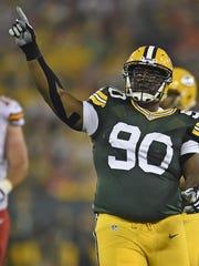 Packers nose tackle B.J. Raji celebrates a defensive