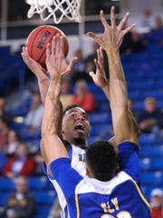 Delaware's Chyree Walker lifts a shot over CSU Bakersfield's Moataz Aly in the first half at the Bob Carpenter Center Wednesday.