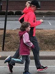 West Chester mom Anjie Britton trains with daughter Ava, 7, for a half-marathon race she is participating in Sunday in New York City's Central Park.