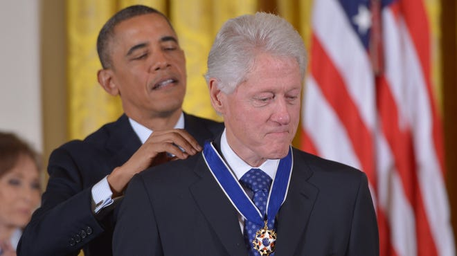 Presidents Obama and Clinton.