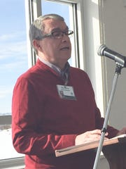 Fairfield Medical Center board chair Ron Burris speaks Wednesday at the hospital's new medical office building in Amanda.
