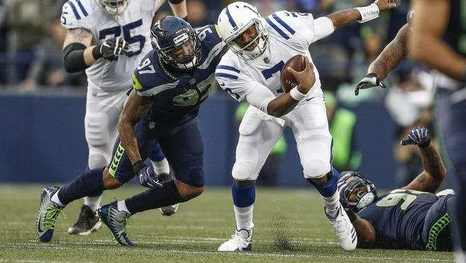 Indianapolis Colts quarterback Jacoby Brissett (7) is sacked by Seattle Seahawks defensive end Marcus Smith (97) at CenturyLink Field in Seattle on Sunday, Oct. 1, 2017.