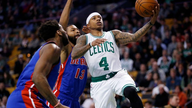 Boston Celtics' Isaiah Thomas (4) goes up to shoot in front of Detroit Pistons' Marcus Morris (13) during the first quarter of an NBA basketball game in Boston, Wednesday, Jan. 6, 2016. (AP Photo/Michael Dwyer)