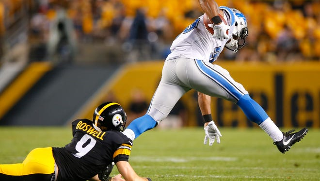 Lions running back Dwayne Washington, right, gets past Steelers kicker Chris Boswell (9) to return a kickoff for a touchdown during the second half of an NFL exhibition football game in Pittsburgh, Friday.