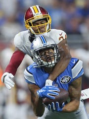 Lions receiver Marvin Jones Jr. makes a 52-yard catch against the Washington Redskins' Josh Norman during the second half Sunday, Oct. 23, 2016 at Ford Field in Detroit.