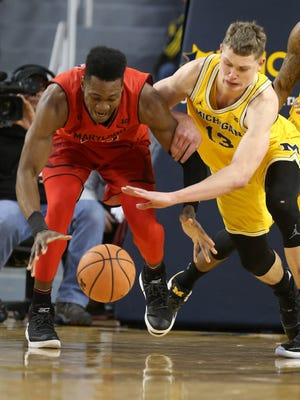 Michigan forward Moritz Wagner goes for the ball against Maryland forward Bruno Fernando during first half action Monday, January 15, 2018 at the Crisler Center.