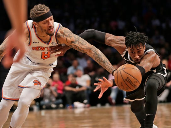 New York Knicks' Michael Beasley, left, and Brooklyn Nets' Rondae Hollis-Jefferson fight for a loose ball during the first half of the NBA basketball game at the Barclays Center, Monday, Jan. 15, 2018 in New York. (AP Photo/Seth Wenig)