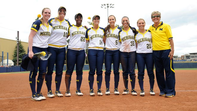 Michigan seniors, from left, with coach Carol Hutchins: Kelsey Susalla, Sara Driesenga, Sierra Lawrence, Lauren Connell, Olivia Richvalsky, Sierra Romero and Mary Sbonek.