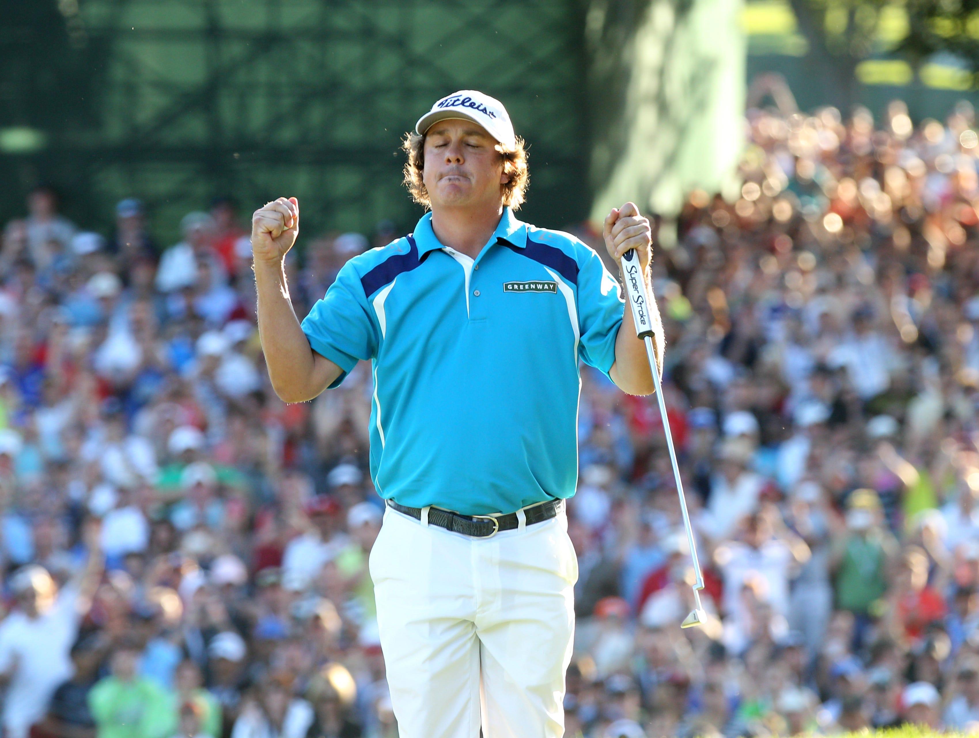 Jason Dufner celebrates his victory at the 95th PGA Championship at Oak Hill Sunday.