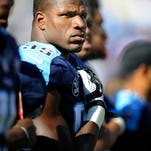 Titans defensive end Kamerion Wimbley, asked last week to take a pay cut, has agreed to a restructured deal.
