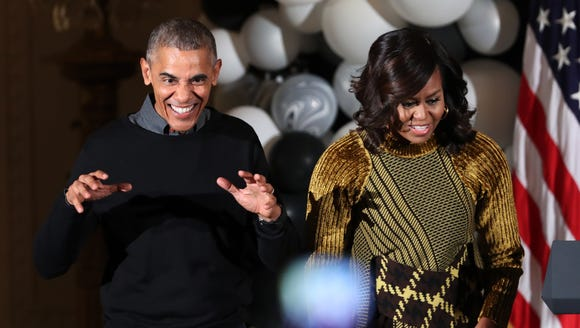 President Obama and first lady Michelle Obama dance