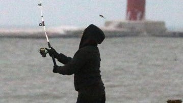 Nick Moeun of Sheboygan said that the weather made it somewhat difficult to stay casting long Tuesday, January 14, 2014 off of south pier.