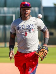 Hanley Ramirez arrived early to spring training and warmed up at first base Wednesday morning. JetBlue Park is warming up for spring training to begin as the Red Sox players trickle in and begin practice and workers begin to set up the ball park.
