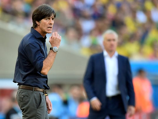 Germany's head coach Joachim Loew, left,  and France's head coach Didier Deschamps stand on the touchline during the World Cup quarterfinal soccer match between Germany and France at the Maracana Stadium in Rio de Janeiro, Brazil, Friday, July 4, 2014. (AP Photo/Martin Meissner)