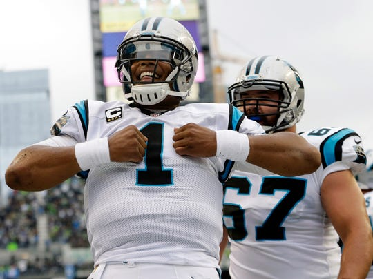 Carolina Panthers quarterback Cam Newton (1) reacts after he rushed for a touchdown in the first half of an NFL football game against the Seattle Seahawks, Sunday, Oct. 18, 2015, in Seattle. (AP Photo/Elaine Thompson)