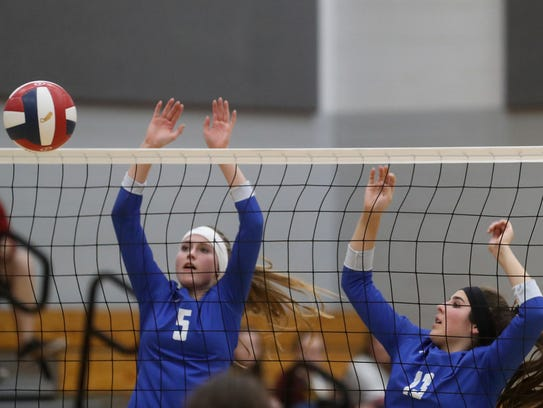 University Prep's Madison Friebel (left) and Savannah Cordova (right) go up for a block in their playoff game against Yreka on Tuesday.