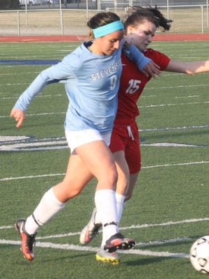 Stevenson's Alia Basierbe pushes the ball upfield during  Tuesday's scrimmage against Divine Child.