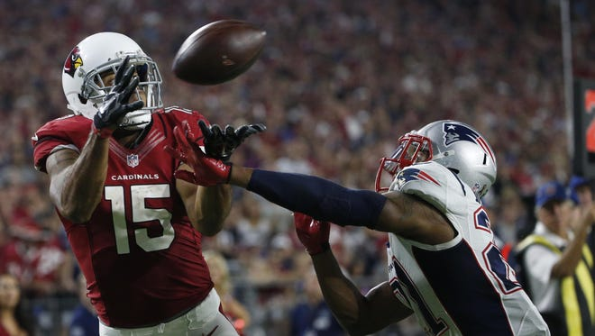 Arizona Cardinals wide receiver Michael Floyd (15) cannot make the catch as New England Patriots cornerback Malcolm Butler (21) defends during the fourth quarter of an NFL football game between the Arizona Cardinals and the New England Patriots in Glendale on Sunday, Sept. 11, 2016.