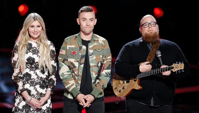 """Lafayette's Hunter Plake, center, stands with Brennley Brown, right, and  Jesse Larson during their Instant Save playoff Tuesday night on """"The Voice."""""""