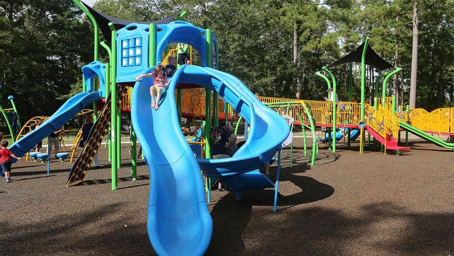 Families turned out as Jacksonville unveiled its first inclusive playground today at Northeast Creek Park.  Where most playgrounds have wheelchair accessible ramps leading to the playground this park accommodates the wheelchairs within the park.