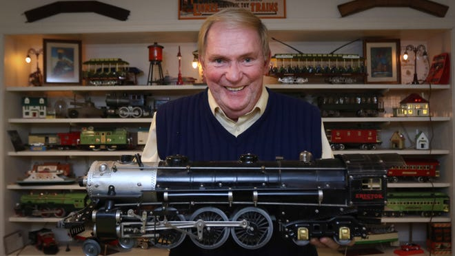 """Dennis Cannon, born on Christmas Eve in 1949, keeps his """"Forever Christmas Eve"""" trains set up yearround in the basement of his Hockessin home."""