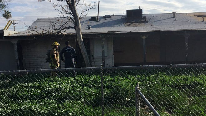 Phoenix firefighters at the scene of a duplex fire in the 5300 block of North 21st Avenue Monday.