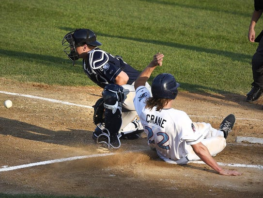 St. Cloud's Connor Crane just beats the throw to Duluth