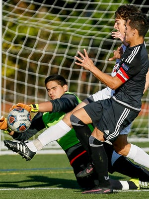 Bernards goalkeeper Andres Lezme cannot take possession as defender Freddy Ludtke (15) races Gill St. Bernard's Kevin Brito (7) to the ball on Tuesday in Bernardsville.