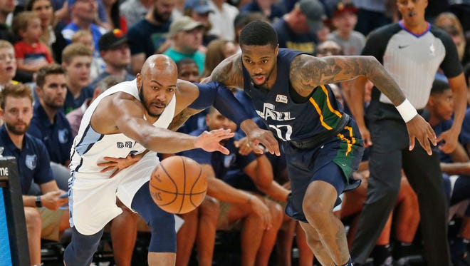 Grizzlies guard Jevon Carter, left, and Jazz guard Kendrick Ray (17) battle for a loose ball during a summer league game last week.