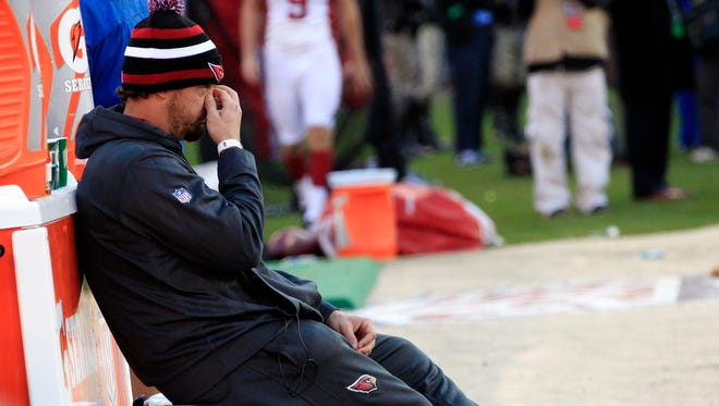 Cardinals injured QB Kevin Kolb  watches his team lose to the 49ers 27-13 at Candlestick Park in San Francisco, Calif. December 30, 2012.