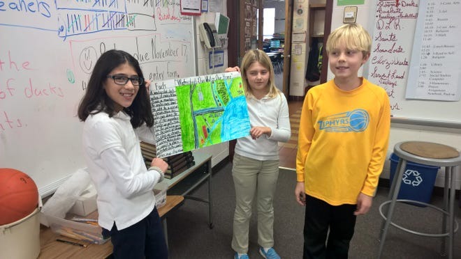 In conjunction with art and science class, fourth-grade students at St. Gabriel Elementary have been learning about the water cycle. They have viewed videos about watersheds, taken notes and created a rough draft for a poster. Their final copy will be entered in the 2018 Conservation Poster Contest sponsored by the Winnebago County Land and Water Conservation Department. Pictured are, from left, Maddox Dwyer, Jimena Argueta and Kaylee Sommerfeld.