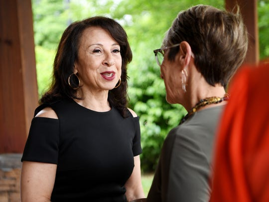 Emmy winning journalist Maria Hinojosa meets guests at Community Foundation of WNC's Power of the Purse May 22, 2018.