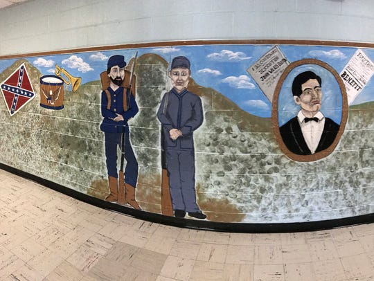 A panoramic photo of a mural in Wappingers' Fishkill Plains Elementary School that depicts Civil War images.