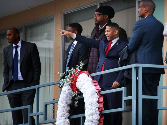"""Historian Ryan Jones points out where James Early Ray shot from while walking the Lorraine Motel balcony at the National Civil Rights Museum Sunday afternoon during a tour. Jones conducted the tour for this year's Legacy Award honorees Anfernee """"Penny"""" Hardaway (left) James Worth (not pictured) Sam Perkins (center) and Swin Cash (right)."""