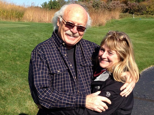 Will and Ann Schmid embrace and enjoy a sunny day. The two were married for 50 years, and they died 44 days apart.