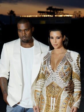 """West and Kardashian arrive for the screening of """"Cruel Summer"""" in Cannes on May 23, 2012."""