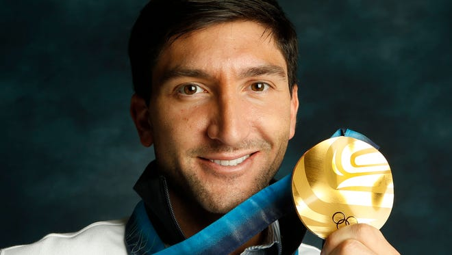 Evan Lysacek poses during a portrait session during the Team USA Media Summit at Canyons Grand Summit Hotel on Sept. 30.