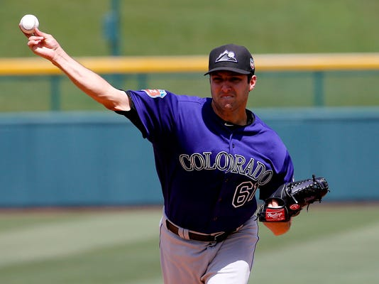Colorado Rockies pitcher David Hale warms up prior to a spring training baseball game against the Chicago Cubs, Wednesday, March 30, 2016, in Mesa, Ariz. (AP Photo/Matt York)
